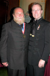 "AHF's Professor Peter Hargitai, 2006 recipient of the Col. Commandant Michael Kovats Medal of Freedom, and Bryan Dawson-Szilagyi wearing traditional Hungarian ""Bocskai"" formalwear"