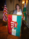 Kato Karasz and her flag she carried as a 1956 refugee