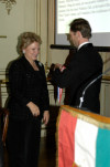 AHF's Asst. Treasurer, Atilla Kocsis, presents the Col. Commandant Michael Kovats Medal of Freedom, AHF's highest award, to 2006 recipient Mary Mochary