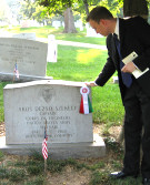 Bryan Dawson-Szilagyi, AHF Executive Committee Chair, placing placing the AHF commemorative ribbon on the grave of Capt. Akos Szekely who died a hero's death in Vietnam.