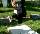 Bryan Dawson-Szilagyi placing the AHF commemorative ribbon on the Odon Gurovits Gravesite.
