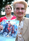 Gabriella Koszorus-Varsa with photo of her painting of of Hussar Michael Kovats, Founding Father of the US Light Cavalry who died fighting the British in South Carolina during the American Revolution