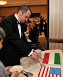 "Embassy Chef Viktor Merényi presented his famed Hungarian ""Dobos Torta"" (Dobos Cakes) draped in the flags of the United States and Hungary. Chef Merényi won the Challenge Sweden competition at the 2010 Embassy Chef Challenge held at the House of Sweden on March 18, 2010"