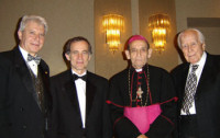 From Left: Stefan J. Fedor, National President of the American Hungarian Federation and Service Delivery Executive at Professor Vasile Beluska, Professor of Violin at Bowling Green State University, Ohio; Bishop Tempfli of Nagyvarad, Romania (Roman Catholic) and Dr. Karoly Levai, Maryland.