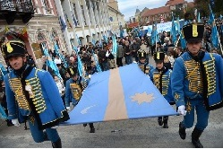 Hungarians carry the Szekely flag in Transylvania